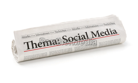 newspaper roll with the heading social