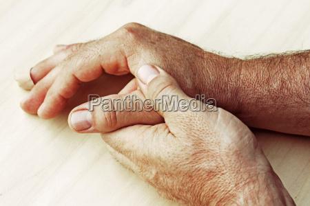 an elderly man has pain in