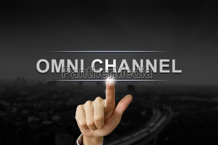 business hand pushing omni channel button