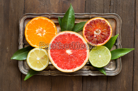 fresh citrus fruits with leaves on
