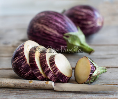 fresh raw striped eggplants and slices