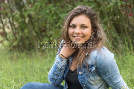 portrait of laughing teenage girl outdoors