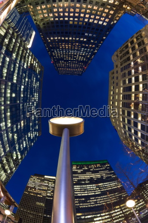 financial district office buildings illuminated at