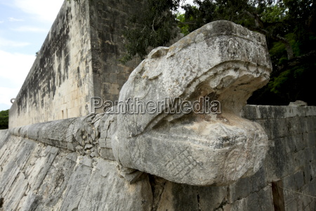 massive stone carving of snake head