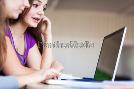 young pretty female college student sitting
