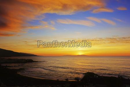 sunset over playa jardin puerto de