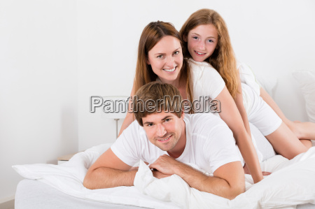 happy family lying on top of