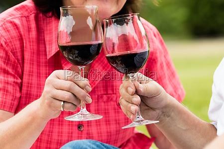 couple toasting glass of wine