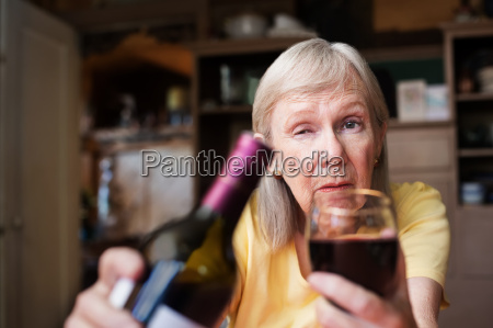 drunk woman offering a glass of