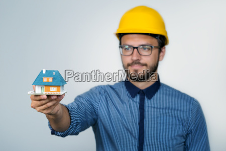 construction engineer showing small house model