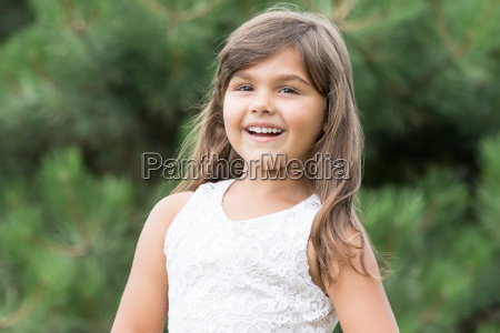 laughing little girl with long hair