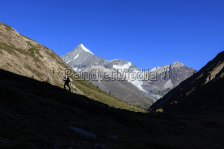 hiker climbs the ridge and in