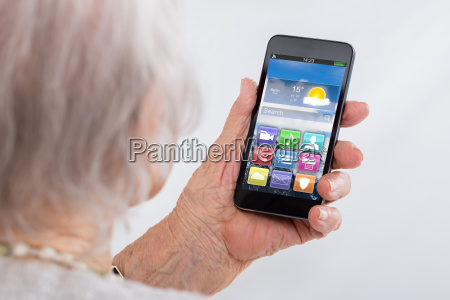 close up of senior woman using