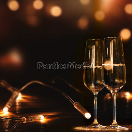champagne glasses in front of a