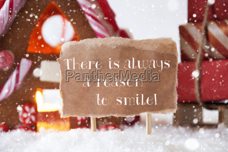gingerbread house with sled snowflakes quote