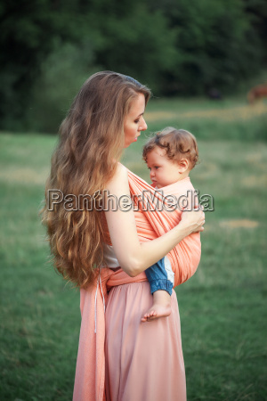 young beautiful mother hugging her little