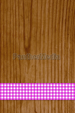 tablecloth pink white on wooden background
