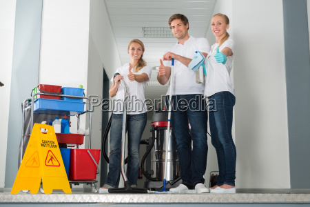 group of happy young janitor showing
