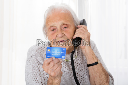 senior woman with credit card on