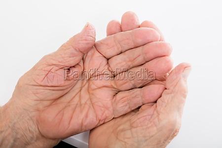 senior woman hand on desk