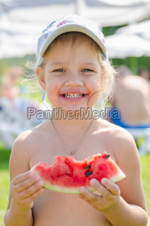 funny cheerful girl eating watermelon close