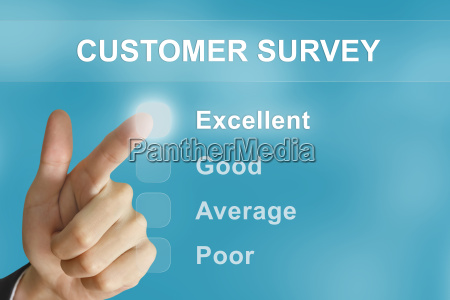 business hand pushing customer survey button