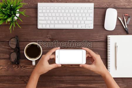 hand holding phone horizontal showing phone