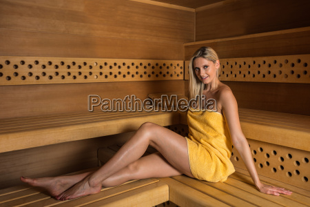 beautiful woman relaxing in sauna