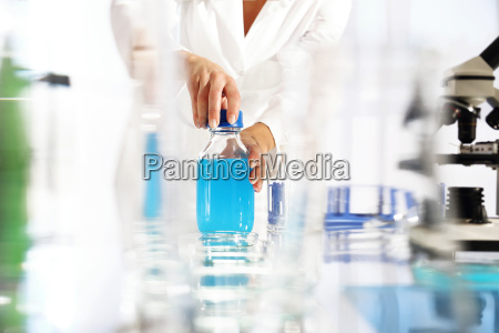 the chemist examines the sample under