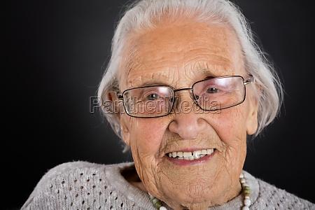 smiling senior woman with eyeglasses