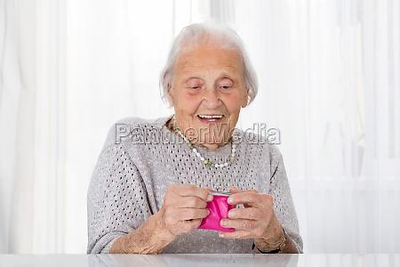 senior woman holding small purse