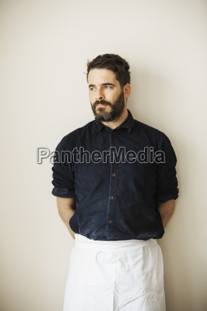 half length portrait of a bearded