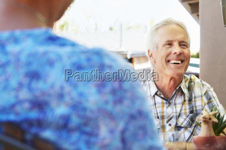 smiling senior man with grey hair