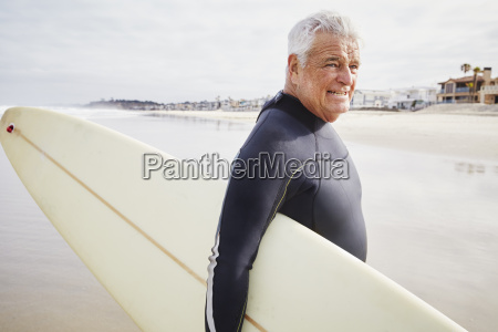 smiling senior man standing on a