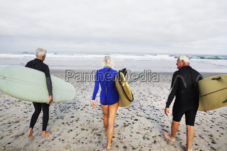 senior woman and two senior men