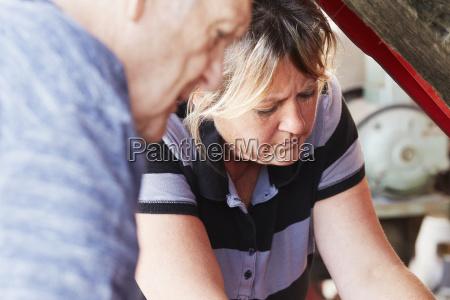 mature woman and senior man repairing