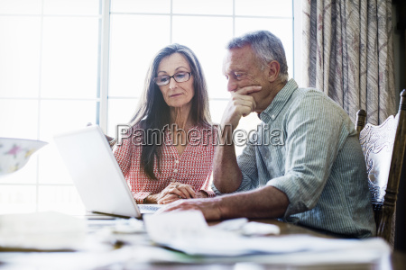 senior couple sitting at a dining