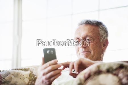 smiling senior man sitting on a