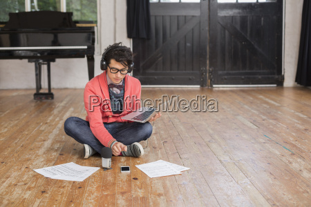 young man sitting on the floor