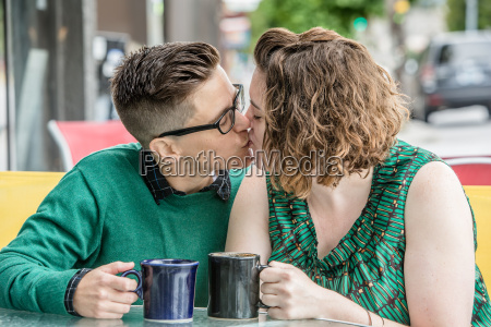 female couple kissing each other