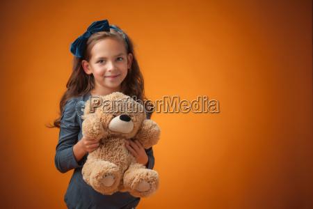 the cute cheerful little girl on