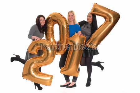 three women hold golden numbers at