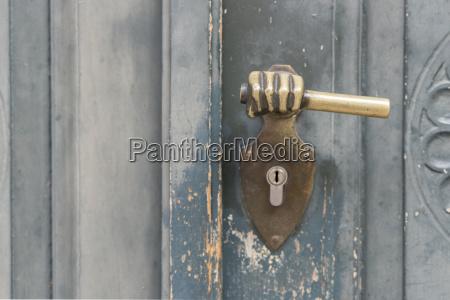 metallic door handle on a