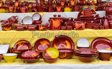 market stand with red pottery