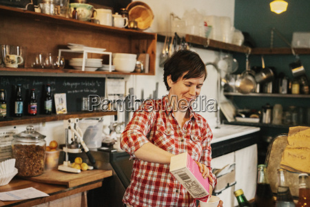 a woman working in a small