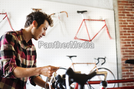 a man in a cycle shop