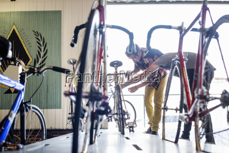 a man working in a bicycle