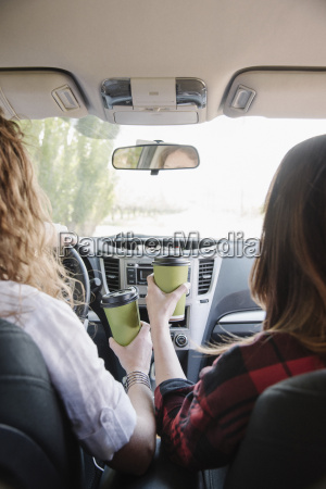 two women in a car holding