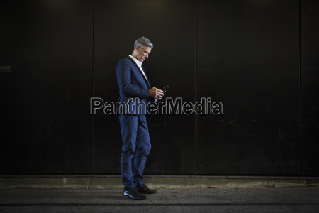 a man in a suit standing