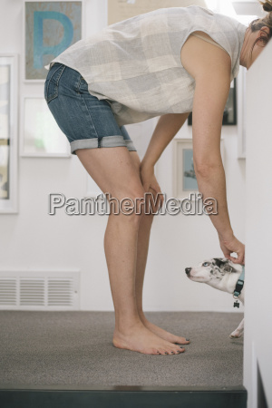 barefoot woman wearing denim shorts standing